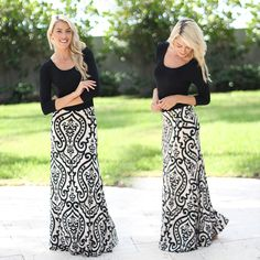 Born to be STUNNING! This new maxi dress is something out of a fairy tale... The printed bottom is so pretty with its amazing classic color combo. We love the 3/4 sleeves and the flawless fit! See this dress in other colors at our online dress boutique!