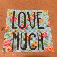 Mini perler bead Mother's Day gift for my mom. She loved it! #sleepystitchshop #mothersday #lovemuch #miniperler #miniperlerbeads #perler #perlerbeads #hama #hamabeads #fusebeads #meltybeads #artkal #8bit #pixel #handmade #homemade #kandi #flowers #love