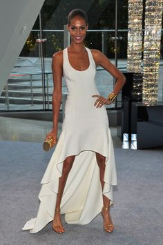 perfection.  this white gown is gorgeous accompanied with gold accessories as well as shoes.
