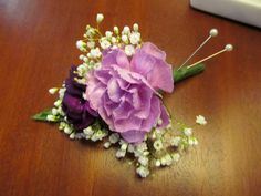 Wedding boutonniere with carnations and babys breath