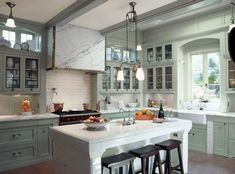An architect's elegant Edwardian kitchen (photo by John Grove). Old House Journal Kitchen Month—30 days of inspiration sponsored by Crown Point Cabinetry   www.crown-point.com