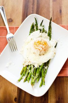 Asparagus with Fried Eggs and Parmesan. A deliciously simple healthy breakfast or light lunch or dinner. One of my favorites!