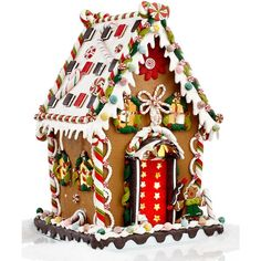Looking good enough to eat, this gingerbread house from Kurt Adler boasts a happy gingerbread man perched outside a delicious house full of sparkling gumballs,…