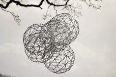 Galvanised Steel #sculpture by #sculptor Will Carr titled: 'Interactions (4 Round garden/Yard Spheres Ball Wire suspended statue)'. #WillCarr
