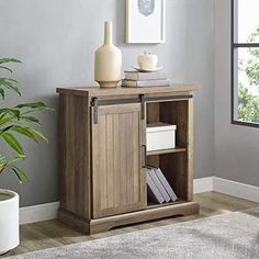 Highlight your living space with this modern farmhouse buffet with a sliding door front to close off either side of the shelving storage. Walker-Edison-Furniture-Modern-Farmhouse-Buffet-Entryway-Bar-Cabinet-Storage-32-Inch-Brown-Reclaimed-Barnwood