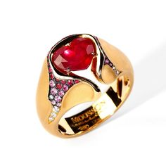 Ring by Mousson Atelier.  Ruby,diamonds, and Sapphire in 18kt. Gold