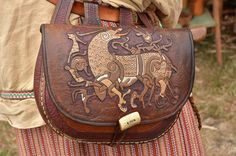 Awesome viking belt bag! There are more and more artisans in eastern Europe, who are able to recapture the ancient pagan spirit in their creations! http://www.wikingowie.bplaced.net/2013/66/galeria66.htm