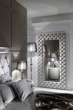 The Large Modern Button Upholstered Nubuck Leather Wall Mirror is striking. A hand-crafted bevelled mirror offering a superb stylish design, seductive, modern and elegant. Made by Italian master craftsmen this design is outstanding in its attention to detail. Feature together in a bedroom along with the gorgeous matching bedside table as shown, or as an over-mantle mirror in a horizontal orientation for a truly sumptuous modern feel, the ultimate in chic Italian style indeed.