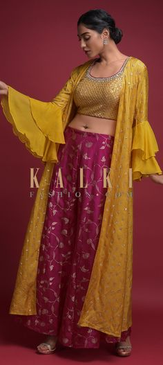 Buy Online from the link below. We ship worldwide (Free Shipping over US$100)  Click Anywhere to Tag Fuchsia Palazzo Suit In Brocade Silk With Yellow Crop Top And Long Jacket With Ruffle Sleeves Online - Kalki Fashion Fuchsia palazzo suit in brocade silk with weaved floral pattern.Matched with contrasting dandelion yellow crop top in cotton silk with zari and sequins embellished Moroccan jaal pattern.