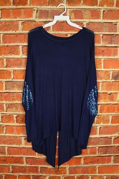 AH, SEQUINS, TUNICS, ELBOW DESIGN! MY favorite!! This one is a little different because the back has a slit in it!   95%RAYON 5%SPANDEX  MADE IN USA