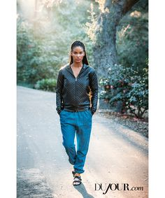 """""""Parenthood"""" actress Joy Bryant and her husband, stuntman Dave Pope, sat down with DuJour to talk about their marriage and life as business partners. On Joy Bryant: Reversible Leather hoodie, price upon request; Military Jogger pant, $190, BASIC TERRAIN. Phillip Buckles sandal, $258, THE FRYE COMPANY. Bryant's own earrings and necklace."""
