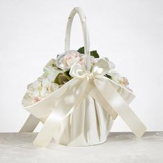 WeddingDepot.com ~ Satin Ivory Flower Girl Basket ~ Gathered soft matte satin covers this flower girl basket inside and out. Soft pleats add softness and continue to bottom of basket. Soft flexible handle.