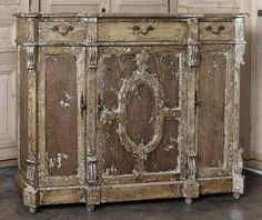 """Perfect for hallways, narrow passages, or just as an unobtrusive piece to put under your large flat panel TV, this intriguing buffet provides surprising storage for a piece only 15 inches deep! Finished with a three-step process that results in a delightful \""""shabby chic\"""" distressed look, it sports three drawers and three cabinets defined by pilasters and fitted with high-quality brass hardware. Measures 43H x 58W x 15D"""