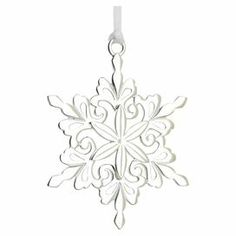 """Hand-cast sterling silver ornament with an openwork snowflake design and white satin hanging ribbon. Made in the USA.  Product: OrnamentConstruction Material: Sterling silver Color: SilverFeatures:  Made in the USAIncludes a white satin ribbon for hangingElegantly packaged for gift-giving and storage Dimensions: 2.87"""" H x 2.25"""" W x 2.25"""" D"""
