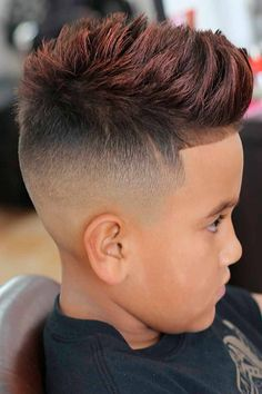 Little boy haircuts can be as trendy and stylish as adult ones. Choose a simple yet cool hairstyle for your toddler, be it a short on sides long on top cut, a black curly faux hawk with a fade or a longer Mohawk. #menshaircuts #menshairstyles #boyshaircuts #littleboyhaircuts #toddlerhaircut