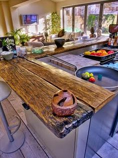 Raw wood counter with industrial type bar chair  #organic_green_and_beautiful_re-use