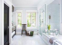 AFTER: The bright, airy bath combines snowy subway tile with marble floors in a herringbone pattern. The generous glass shower takes full advantage of the surroundings and makes the room look more spacious.