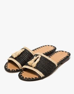 From Carrie Forbes, a minimalist sandal in Black and Natural. Featuring a handwoven raffia upper, handwoven raffia tassels, Italian leather sole, branded insole and a slightly stacked heel. • Sandal in Black and Natural • Handwoven raffia upper • Han