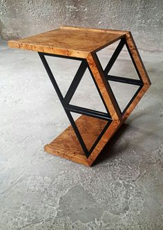 Triangle Coffee Table The coffee table is formed by triangles. The design gets it's name from it's geometric shape.