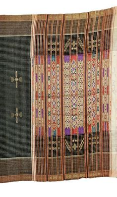 Africa | Detail from a Ceremonial Asymmetric shawl from Djerba, Tunisia | Cotton; a central panel of white squares on a black background with densely woven borders, the lower part richly embroidered with horizontal bands of abstract decorations worked in metal threads and with fringing