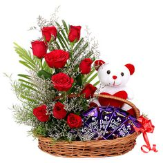 Red roses flowers with soft toys and chocolates