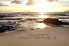 happy anniversary written in the sand