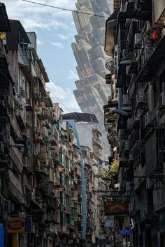 A street in Macau with the Grand Lisboa Casino looming in the background. Photograph by Paul Tsui, National Geographic travel photographer of the year. - A street in Macau with the Grand Lisboa Casino looming in the background. Photograph by Paul Tsui, - Macao, National Geographic Travel, Scary Places, Ghost In The Shell, Travel Photographer, Futuristic, Just In Case, Scenery, Pictures