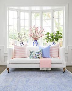 Katie Nixon Photography - White living room boasting a white sofa with a Caitlin Wilson French Gingham Pillow, a Caitlin Wilson Provence Stripe Pillow and a Caitlin Wilson Citron Vert Pillow. Living Pequeños, Rugs In Living Room, Home And Living, Living Room Decor, Home Interior, Interior Design, Blue Rooms, Blue And Pink Living Room, Pastel Living Room