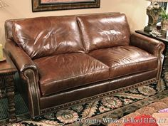 brown leather 2-cushion sofa with nail heads- Country Willow Furniture