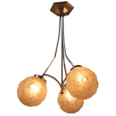 Three Globes Art Deco Chandelier | From a unique collection of antique and modern chandeliers and pendants  at https://www.1stdibs.com/furniture/lighting/chandeliers-pendant-lights/
