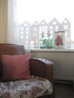 Love this window decoration -- up-cycled cardboard, whitewashed. Love love love it