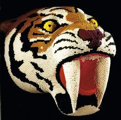 Tiger sculpture made entirely of match sticks. Cool!