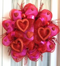Definitely going to start making these Mesh wreaths! I love this Valentine one =) M.J.