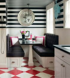 Bold black and white striped walls and a graphic diamond-patterned floor make a cramped kitchen look like a hip eatery.  Source - www.casasugar.com