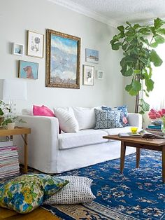 Emily Henderson's living room - the room I would copy almost to the hot pink pillow.  Not so different from my own living room, actually.  Definitely always love a white/blue combo.