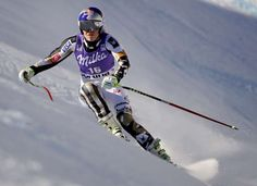 United States's Lindsey Vonn speeds down the course during an alpine ski, women's World Cup downhill training, in Cortina d'Ampezzo, Italy, Friday, Jan. 27, 2017. (AP Photo/Domenico Stinellis)