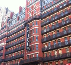The Hotel Chelsea ...Also known as The Chelsea Hotel.....  222 West 23rd Street....  Built in 1884 is a New York City Landmark that boast 250 units and is known primarily for its history of Notable residents.....Including Bob Dylan, Janis Joplin, Patti Smith, Iggy Pop, Leonard Cohen and the list goes on...  It has been featured in movies and was Family from PBS in 1993...  It is a beautiful and fascinating building...Check out Wikipedia for all kinds of links and history... Chelsea Hotel, Iggy Pop, Patti Smith, Leonard Cohen, Janis Joplin, Bob Dylan, Empire State, New York City, To Go