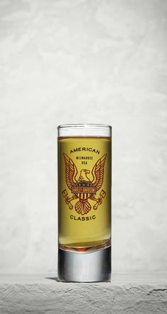 The American Classic Cordial (with a red-tinted base) features our red, white, and blue eagle icon. | Harley-Davidson American Classic Cordial Harley Davidson History, Harley Davidson Motorcycles, Eagle Icon, Harley Davidson Online Store, Motorcycle Parts And Accessories, Cordial, Riding Gear, Best Beer, Shot Glass