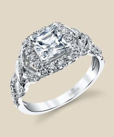 Diamond accented LYRIA vines twist toward a halo-enveloped princess-cut diamond. Diamond Info: 66-RD 0.48 CTS Fits center stone size SQ: 5.5-6.0 MM GUIDE Center stone not included.