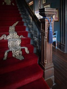 An alligator-print carpet runner features on the stairs. New Orleans Hotels, New Orleans Tourism, Orange Leather Sofas, Pool Shade, Chloe, Private Dining Room, Rug Company, Tall Ceilings, Small Buildings