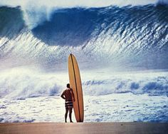 Greg Noll in a showdown at Pipeline in Hawaii, 1964. All photographs: John Severson/Puka Puka/Damiani