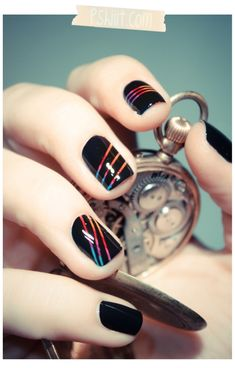 Love this manicure. Paint nail polish stripes, apply french manicure strips, paint black and then remove strips. Peekaboo rainbow nails.