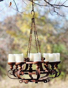Rustic Outdoor Barnyard Chandelier this would look so cute for a wedding.