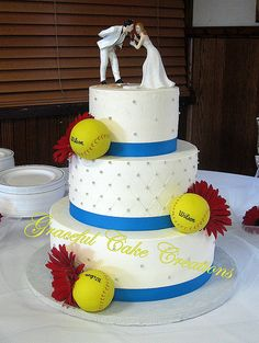 Softball Themed Wedding Cake with Malibu Blue Ribbon and Red Gerberas