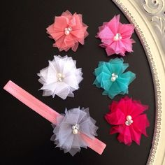 Sweet Pea Flower with Interchangeable by HarChloBandsAndBows.... I'd wear them! ;)