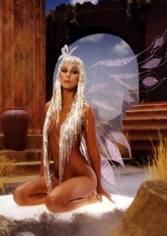 I dreamed of Cher wearing nothing save for a shimmering wig made of tinsel....