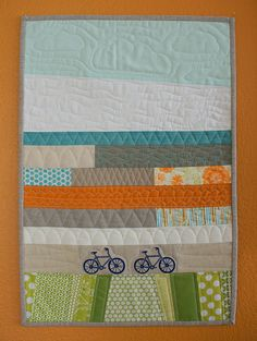 bicycle quilt - I think it's a baby quilt, but it would be super cute as the focal point in a master bedroom with the two bicycles. <3