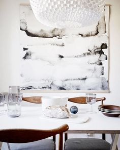 { A monochromatic dinning space with touches of wood }