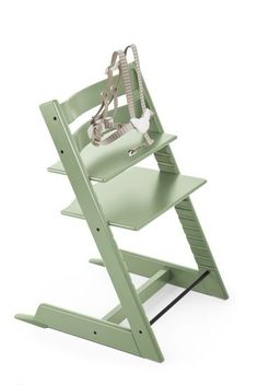 Tripp Trapp® Moss Green high chair that adjusts as your baby gets older.