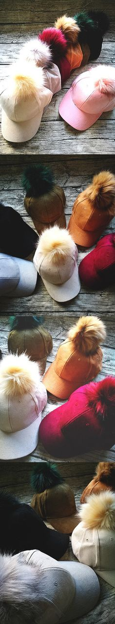 Suedette Faux Fur Pom Cap $12, Seven colors to choose from. Classic baseball cap with cute soft fur ball.